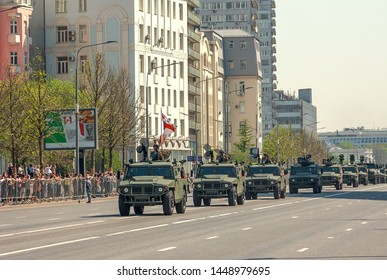 """MOSCOW, RUSSIA - MAY 2019: Head of column of military equipment returning along New Arbat from rehearsal for Victory Parade on Red Square. Armored cars """"Tigr-M""""."""