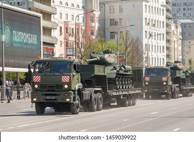 MOSCOW, RUSSIA - MAY 2019: Legendary Soviet tanks T-34-85 on   KAMAZ-65225 war trailer. Preparing for military parade in honor of Victory Day.