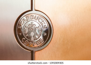 Moscow, Russia - May 2019: Starbucks Coffee Machine With Starbucks Logo. Starbucks Sign Closeup.