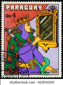 """MOSCOW, RUSSIA - MAY 21, 2016: A stamp printed in Paraguay shows Queen at the magic mirror, series """"International Year of the Child - Grimm's Fairy Tale 'Snow White and the Seven Dwarfs'"""", circa 1978"""