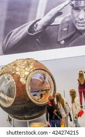"""MOSCOW, RUSSIA - MAY 21, 2016: fragment of the museum exposition (Multimedia Art Museum - MAMM), devoted to first human to journey into outer space: Yuri Gagarin photo and the Space lander """"Vostok""""."""