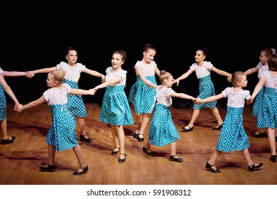 MOSCOW, RUSSIA - MAY 21, 2016: Girls dance in a circle holding hands during concert of dance studio Firebird in Bogorodskoye.