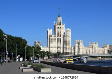 MOSCOW, RUSSIA - MAY 21, 2018: Moscow River, Moskvoretskaya Embankment, Big Ustyinsky Bridge and High-Rise Building on Kotelnicheskaya Embankment. The inscription on the car: DPS (Road Patrol Service)