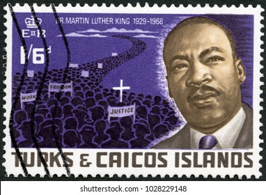 MOSCOW, RUSSIA - MAY 22, 2016: A stamp printed in The Turks and Caicos Islands shows Dr. Martin Luther King, Jr. (1929-1968) and Protest March of 1968, American civil rights leader, 1968