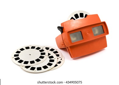 MOSCOW, RUSSIA - MAY 23, 2016: Red retro stereoscope isolated with reels on white background