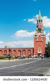 MOSCOW, RUSSIA - may 23, 2018: Spasskaya tower and the wall of the Moscow Kremlin and tourists walking on the square