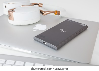 Moscow, Russia - May 25, 2015: BlackBerry Leap back, Apple MacBook Pro Retina and Parrot Zik ear-flaps. Smart phone was released at Mobile World Congress in Barcelona on March 3, 2015.