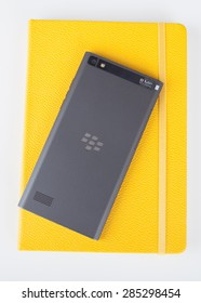 Moscow, Russia - May 25, 2015: BlackBerry Leap back and yellow notebook. It was released at Mobile World Congress in Barcelona on March 3, 2015.