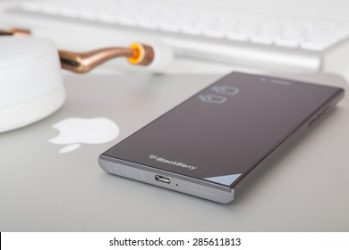 Moscow, Russia - May 25, 2015: BlackBerry Leap, Apple MacBook Pro Retina and Parrot Zik ear-flaps. Smart phone was released at Mobile World Congress in Barcelona on March 3, 2015.