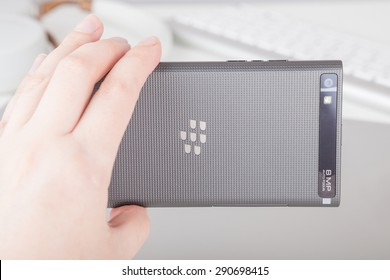Moscow, Russia - May 25, 2015: Woman holding a BlackBerry Leap against accessorizes. It was released at Mobile World Congress in Barcelona on March 3, 2015.