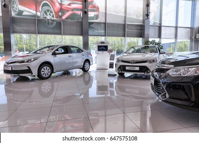Moscow, Russia - May 25, 2017: Selling cars Toyota in the showroom. New products automaker Toyota