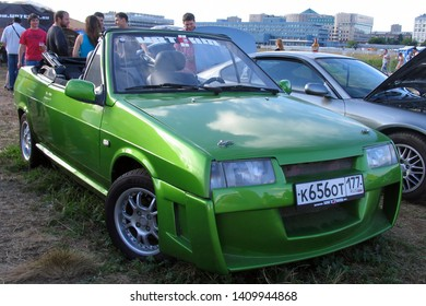 Moscow, Russia - May 25, 2019: Exclusive convertible old automobile. Russian car Lada. Vaz Natasha in green color tuned with body kit.