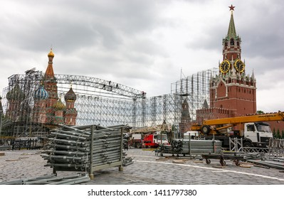 Moscow, Russia - May 25, 2019: Rigging equipment on Red Square over background of high rise workers performing rigging operations on scaffolding.