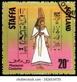 MOSCOW, RUSSIA - MAY 25, 2019: Postage stamp printed in Cinderellas shows Pharaonic costume, 20 p due, Staffa Scotland serie, circa 1980