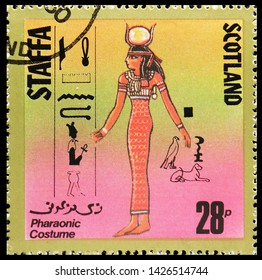 MOSCOW, RUSSIA - MAY 25, 2019: Postage stamp printed in Cinderellas shows Pharaonic costume, 28 p due, Staffa Scotland serie, circa 1980