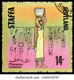 MOSCOW, RUSSIA - MAY 25, 2019: Postage stamp printed in Cinderellas shows Pharaonic costume, 14 p due, Staffa Scotland serie, circa 1980