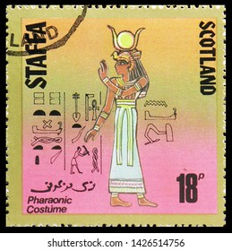 MOSCOW, RUSSIA - MAY 25, 2019: Postage stamp printed in Cinderellas shows Pharaonic costume, 18 p due, Staffa Scotland serie, circa 1980