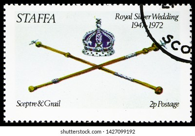 MOSCOW, RUSSIA - MAY 25, 2019: Postage stamp printed in Cinderellas shows Sceptre and Grail, Royal silver wedding, Staffa Scotland serie, circa 1972
