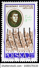 MOSCOW, RUSSIA - MAY 25, 2019: Postage stamp printed in Poland shows Nicolaus Copernicus, By Zinck Nora and view of Ferrara, Copernicus serie, circa 1970