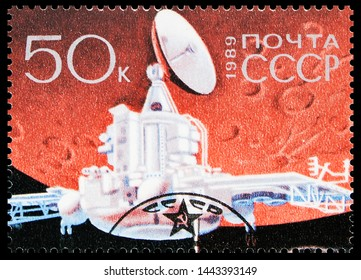 MOSCOW, RUSSIA - MAY 25, 2019: Postage stamp printed in Soviet Union shows International Space Project Phobosa, Soviet Phobos probe approaches Mars serie, circa 1989