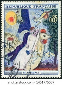 MOSCOW, RUSSIA - MAY 25, 2019: A stamp printed in France shows The Married Couple of the Eiffel Tower, by Marc Chagall (1887-1985), 1963