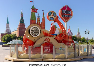 MOSCOW, RUSSIA - MAY 26, 2018:  Watches, leading a countdown of time left before the start of the World Cup 2018 in Russia (Moscow, Manezhnaya Square). Kremlin and Manezh square with on background.