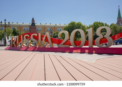 "MOSCOW, RUSSIA - MAY 26, 2018: The inscription ""Russia 2018"" installed before start of FIFA World Cup at Manezh Square. Walking people, Kremlin and Manege Square on the background."