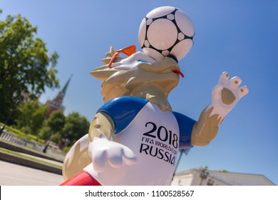 MOSCOW, RUSSIA - MAY 26, 2018: Official Mascot of FIFA 2018 World Cup in Russia - Zabivaka and Moscow Kremlin tower at background. Symbol of Football (Soccer) Championship 2018, Zabivaka Wolf Mascot.