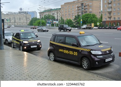 MOSCOW, RUSSIA - MAY 27, 2013: Daihatsu Materia (Daihatsu Coo in Japan) is a mini MPV produced by the Japanese car company Daihatsu. Taxi car in Moscow.