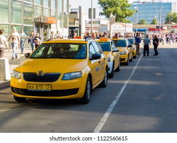 """MOSCOW, RUSSIA - MAY 27, 2018: """"New Yellow Taxis"""" in front of the  Kursky railway station."""