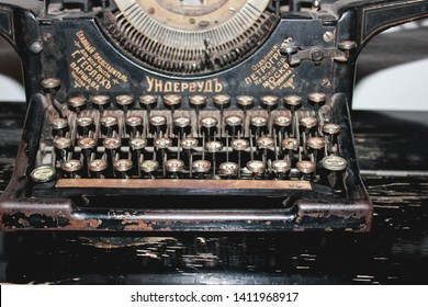 Moscow, Russia - May 27, 2019: Underwood Typewriter, is a vintage mechanical typewriter by Wagner Typewriter Co. On a wooden table. Sign says: Underwood, the main representative in Russia