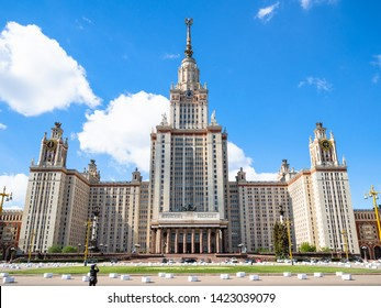 MOSCOW, RUSSIA - MAY 27, 2019: tourist take photo of north facade of The Main Building of Moscow State University (Lomonosov State University of Moscow) from University square in sunny day