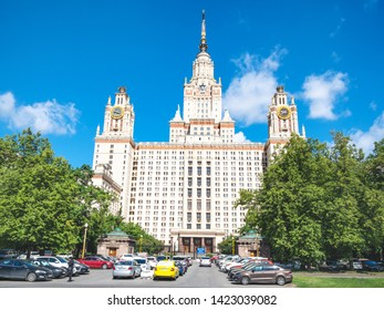 MOSCOW, RUSSIA - MAY 27, 2019: car parking in University garden and view of east facade of The Main Building of Moscow State University (Lomonosov State University of Moscow) in sunny summer day