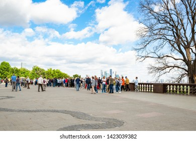 MOSCOW, RUSSIA - MAY 27, 2019: visitors on observation deck on Sparrow Hills (Vorobyovy Gory) in Moscow city. The height of the viewpoint is about 80 meters above the level of the Moscow River