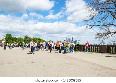 MOSCOW, RUSSIA - MAY 27, 2019: people on observation deck on Sparrow Hills (Vorobyovy Gory) in Moscow city in summer. The height of the viewpoint is about 80 meters above the level of the Moscow River