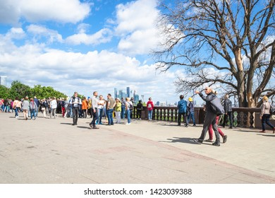 MOSCOW, RUSSIA - MAY 27, 2019: tourists on observation deck on Sparrow Hills (Vorobyovy Gory) in Moscow in summer. The height of the viewpoint is about 80 meters above the level of the Moscow River