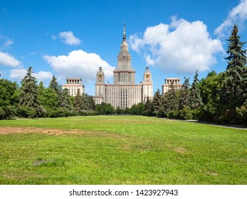 MOSCOW, RUSSIA - MAY 27, 2019: view of The Main Building of Moscow State University (Lomonosov State University of Moscow) and green lawn in courtyard in sunny summer day