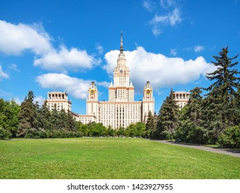 MOSCOW, RUSSIA - MAY 27, 2019: view of east facade of The Main Building of Moscow State University (Lomonosov State University of Moscow) and green lawn in yard in sunny summer day