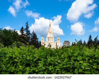 MOSCOW, RUSSIA - MAY 27, 2019: view of towers of The Main Building of Moscow State University (Lomonosov State University of Moscow) from green park in sunny summer day