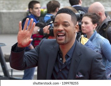 MOSCOW, RUSSIA - MAY 27: Will Smith takes photo with a fan during a photo-call for the film After Earth on May 27, 2013 in Moscow
