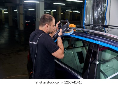 Moscow. Russia. May 29, 2018. A man polishes a blue Mercedes car ml.