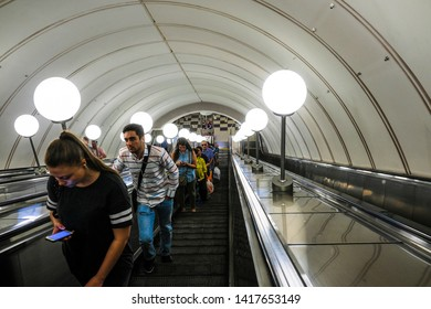 Moscow, Russia - May, 29, 2019: image of people on the Minskaya Metro station on excalator in Moscow