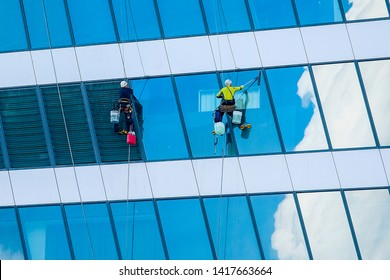 Moscow, Russia - May, 29, 2019: Steeplejacks Work on a Wall in Moscow