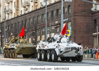 Moscow, Russia - May 3, 2018: Russian troopers in the arctic version of the BTR-82A with a 30-mm cannon 2A72 on Tverskaya street before beginning of night rehearsal of the parade on Red Square.