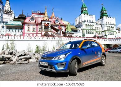 Moscow, Russia - May 3, 2018: Belka Car carsharing motor company's Kia Rio X-Line in the city street at the background of the Izmaylovo Kremlin wall.