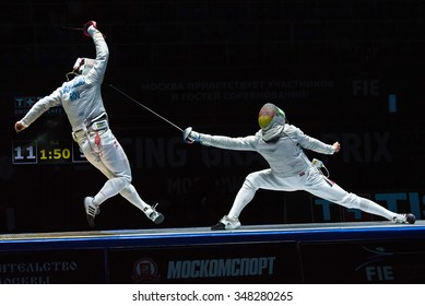 MOSCOW, RUSSIA - MAY 30, 2015: Romanian Tiberiu Dolniceanu against German Matyas Szabo in the finals of the men individual event at the 2015 Moscow Sabre international fencing tournament.