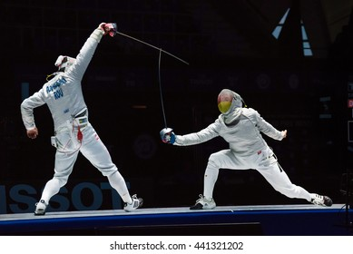 Moscow, Russia - May 30, 2015: Romania's Tiberiu Dolniceanu against Germany's Matyas Szabo in the finals of the men's individual event at the 2015 Moscow Sabre international fencing tournament.