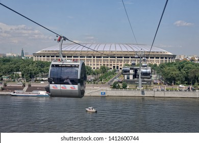 MOSCOW, RUSSIA - May 30, 2019 View from a cabin on the trhe first Moscow cable car over the river Moskva (Moscow) in background of Luzhniki stadium.