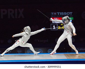 MOSCOW, RUSSIA - MAY 31 2015: Jung Kim attack Sofia Velikaya on the World  fencing Grand Prix Moscow Saber in Luzhniki sport palace