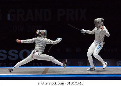 MOSCOW, RUSSIA - MAY 31 2015: O. Kharlan (L) and V. Vougiouka (R) just before finals on the World  fencing Grand Prix Moscow Saber in Luzhniki sport palace